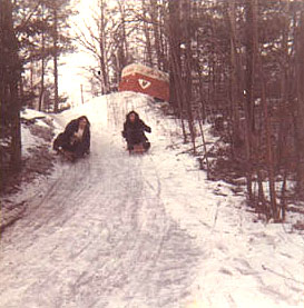 Bozzo and Meatloaf sledding 1
